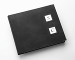 As our Reportage Luxury album, finished with a luxurious soft touch suede material, but featuring two aperture positions to hold our range of plaques depicting the initials of the bride and groom.